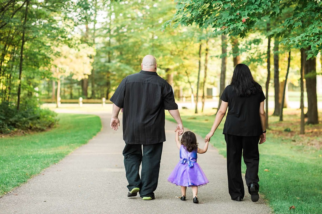 image of family walking into woods